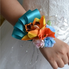 Orange Lily Wrist Corsage with Blue Ribbon
